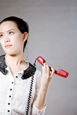 Young angry woman yelling on phone Stock Photo - 13632689