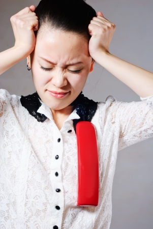 Young angry woman yelling on phone Stock Photo - 13632620