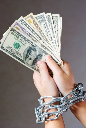 Hands with dollars in chain on a white background photo
