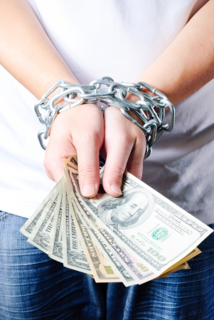 Hands with dollars in chain on a white background Stock Photo - 13632721