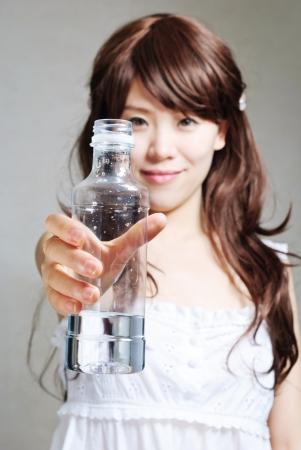 portrait of woman with bottle of water Standard-Bild