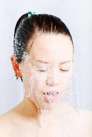 young beautiful attractive woman taking shower Stock Photo - 13632609
