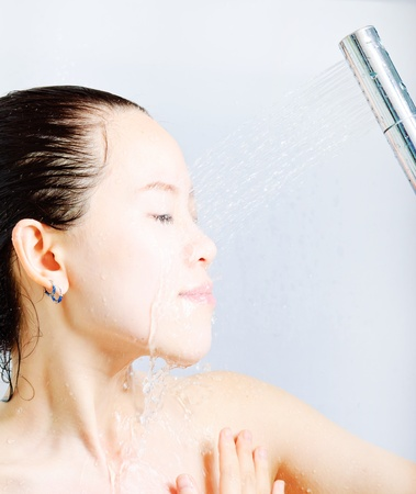 young beautiful attractive woman taking shower Stock Photo - 13632565