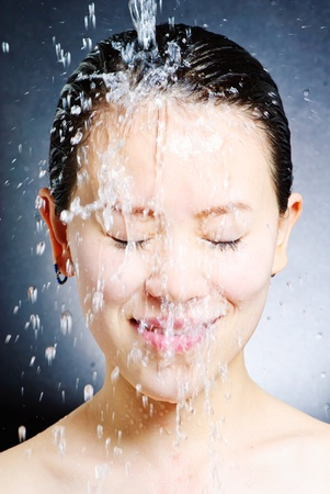 young beautiful attractive woman taking shower Stock Photo