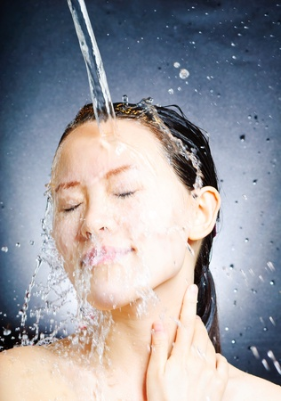 young beautiful attractive woman taking shower Stock Photo - 13632672