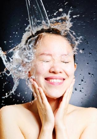 young beautiful attractive woman taking shower Standard-Bild