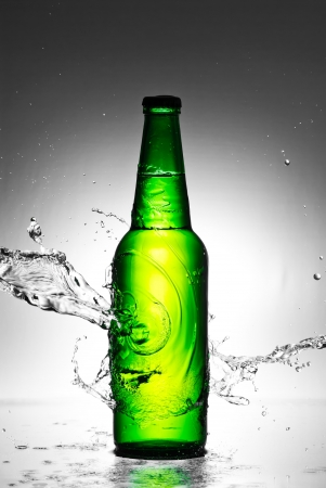 Beer bottle with water splash Stock Photo - 13851452