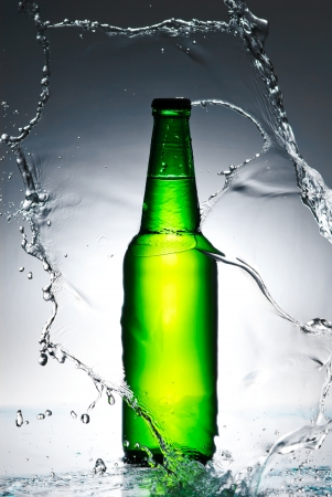 Beer bottle with water splash photo