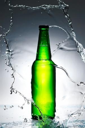 Beer bottle with water splash Stock Photo - 13851557