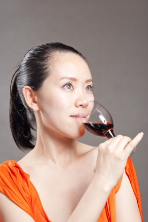 Beautiful woman with glass red wine photo