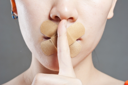 Young women stick the concept of the mouth