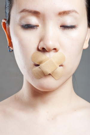 Young women stick the concept of the mouth  photo