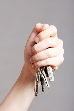 accommodation broker: Young women with a key Stock Photo