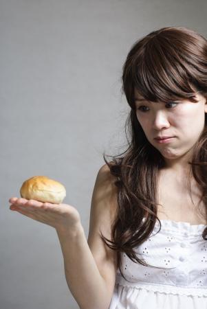hungry beautiful girl eats a tasty hamburger Stock Photo - 13875190