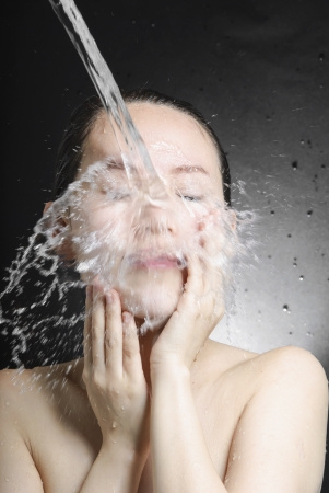 young beautiful attractive woman taking shower photo