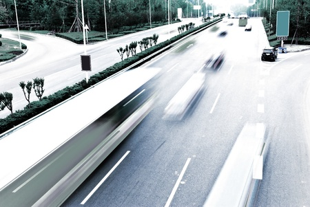 Highway with lots of cars. Blue tint, high contrast and motion blur to rise speed. photo