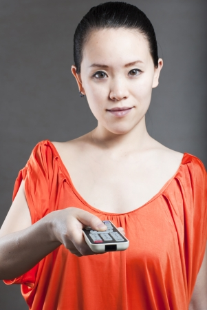 Young women with a remote control photo