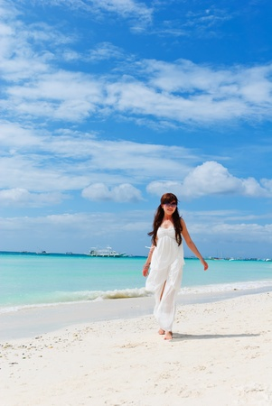 Woman on the beach in the summertime Stock Photo