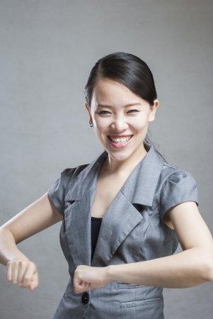 Happy Asian woman with her arms in the air cheering Stock Photo - 14245727