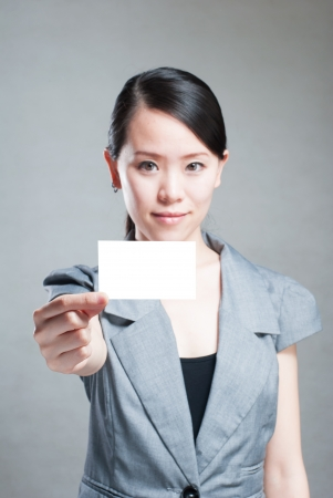 Beautiful business woman with a white banner. photo