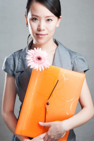 bright picture of beautiful woman with folders Stock Photo - 14245654