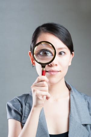 Portrait of lovely young woman with magnifying glass showing her white teeth Stock Photo - 14245680