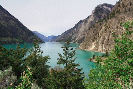 The clean green water of lillooet lake on the foot of mount