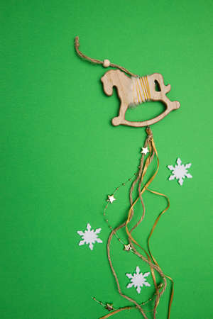 Christmas decoration wooden horse with stars, ribbons and beads