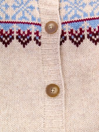 Two buttons on knitted fabric with pattern photo