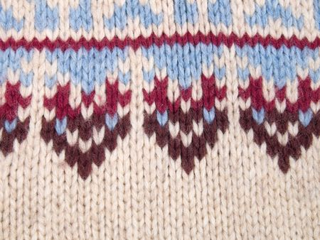 Close up of knitted fabric with blue and red pattern photo