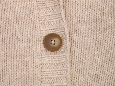 Close-up of button on knitted fabric photo