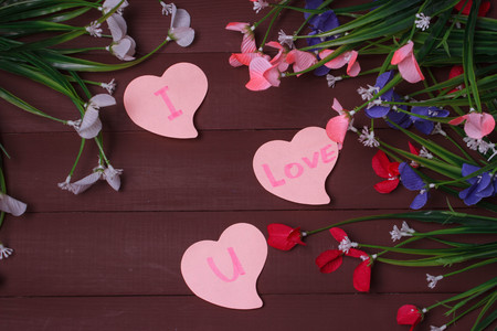 i love u: Card with Message Love You on the Letter on wooden background flowers