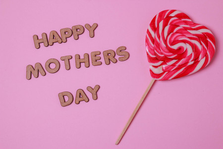 heart shaped: mothers day concept. HAPPY MOTHER DAY alphabet with colorful heart and red bucket on blue background