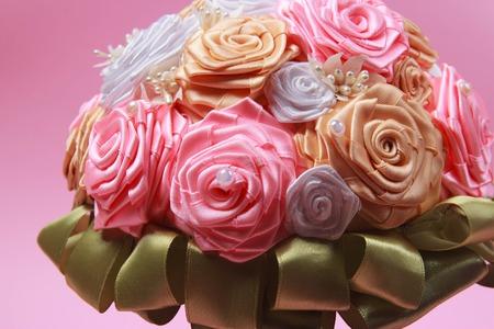 Wedding bouquet on pink background