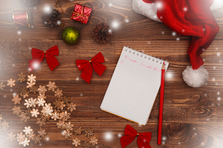 christmas and new year background with notepad pen and decorations to do list or