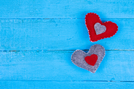 Two soft hearts on blue wooden background valentine background Stock Photo