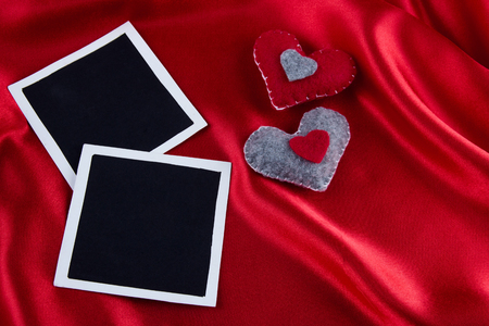 Photos frames on rustic red satin background Stock Photo