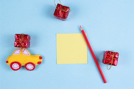 toy of felt yellow typewriter with red gift with pencils and place for text. Top view