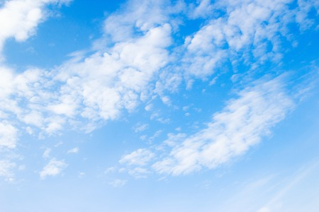 White clouds on the blue sky. Sky texture Stock Photo