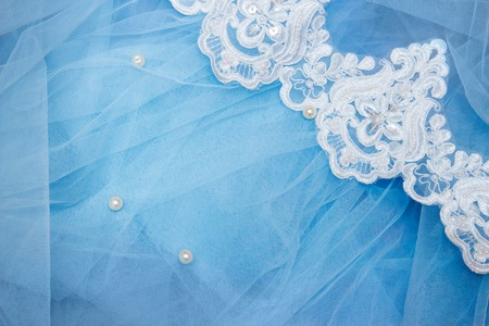 Lace on blue tulle with beads. Sewing a wedding dress. wedding concept Archivio Fotografico