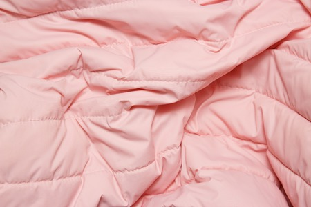 Textile and texture concept. Close up of pink fabric background. Stock Photo