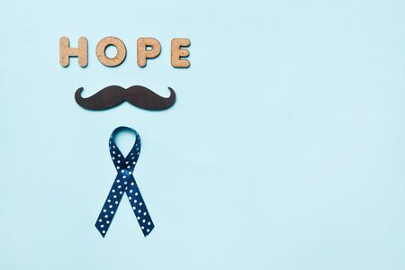 Blue ribbons with mustache and word hope. Prostate Cancer Awareness. Men health awareness. Movember concept.