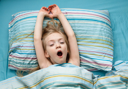 sees: Little girl 5 years old sleeps and sees a beautiful dreams