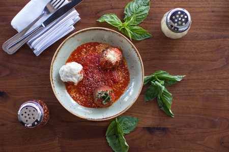 Meatball sampling with burrata mozzarella, fresh basil, and crushed red pepper