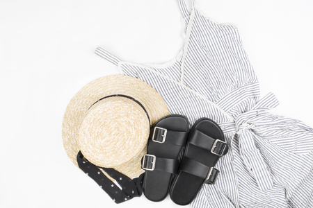 Collection collage of womens clothing. Sundress-dress, straw hat, sandals. Top view, flat lay. Reklamní fotografie