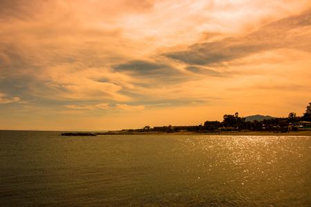 Sunset beach. Beautiful sunset view. Puerto Banus, Marbella city, Costa del Sol, Andalusia, Spain.