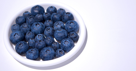 Blueberry. Close-up view of fresh blueberries isolated on white background.