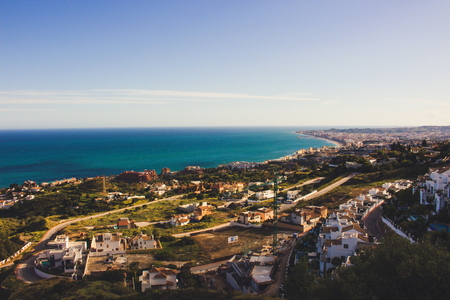 A view from the viewpoint over the hill near The Buddhist Stupa in Benalmadena town. Fuengirola and Mediterranean sea. Stock Photo