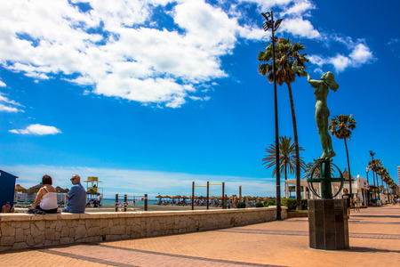 Promenade A sunny day on the beach of Fuengirola. Malaga province, Andalusia, Spain. Picture taken ? ? 5 june 2018.