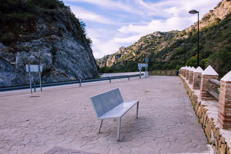 Scenery of Acequia del Guadalmina with empty bench 版權商用圖片